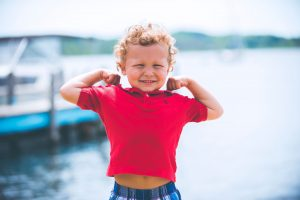 Boy in Red Shirt By Water